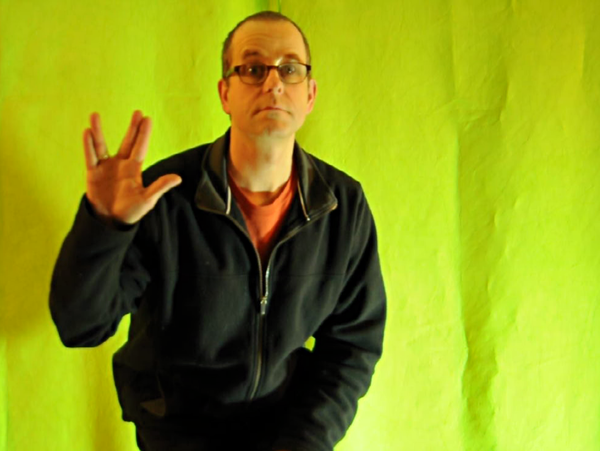 Actor in front of a green screen